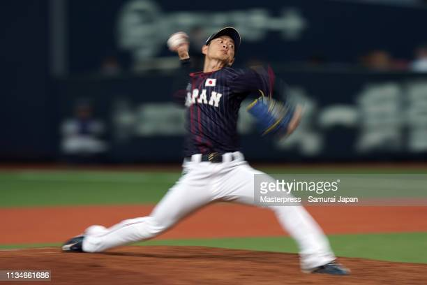 Pitcher Taisuke Yamaoka of Japan throws in the bottom of 4th inning during the game one between Japan and Mexico at Kyocera Dome Osaka on March 9...