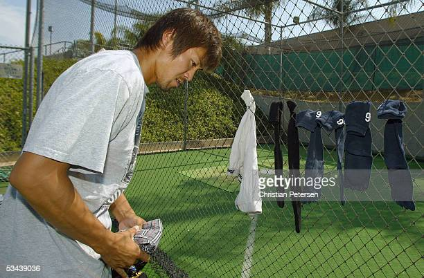Pitcher Takaaki Igarashi of the Japan Samurai Bears hangs his laundry up to dry before the start of the Golden Baseball League game against the...