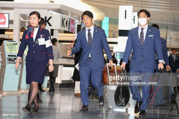 Pitcher Takahiro Norimoto and Infielder Kosuke Tanaka of Japan are seen on departure for the United States for the World Baseball Classic...