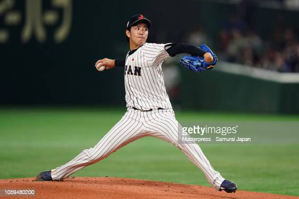 Pitcher Takayuki Kishi of Japan throws in the top of 1st inning during the game one of the Japan and MLB All Stars at Tokyo Dome on November 9, 2018...