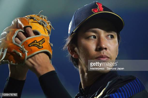 Pitcher Takayuki Kishi of Japan warms up prior to the game one of the Japan and MLB All Stars at Tokyo Dome on November 9, 2018 in Tokyo, Japan.