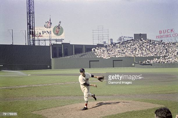 Pitcher Tex Hughson of the Boston Red Sox warms up prior to a game in July 4, 1947 against the Philadelphia A's at Fenway Park in Boston,...
