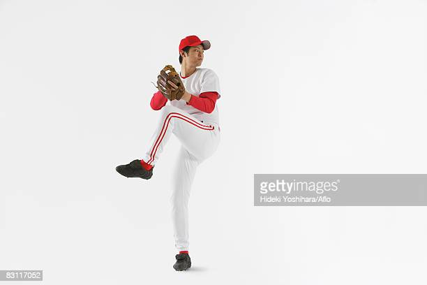 pitcher throwing baseball - baseball pitcher stock pictures, royalty-free photos & images