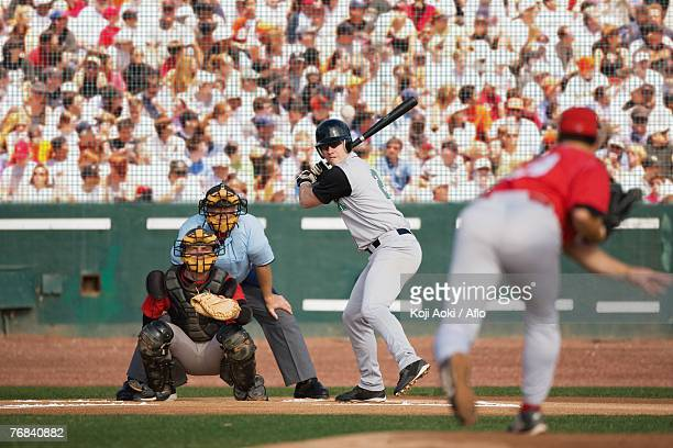 pitcher throwing - baseball catcher stock photos and pictures