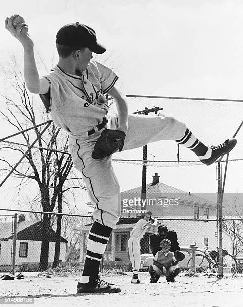 5/21/1954 Pitcher Tim Springer falls into this classic pose as he prepares to fill catcher Patrick Devine's signal for a fast one Batter is Clifford...