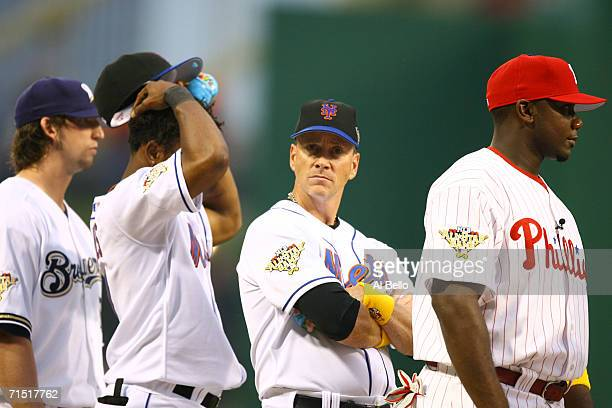 Pitcher Tom Glavine of the National League AllStar team glances at the camera before the start of the 77th MLB AllStar Game against the American...