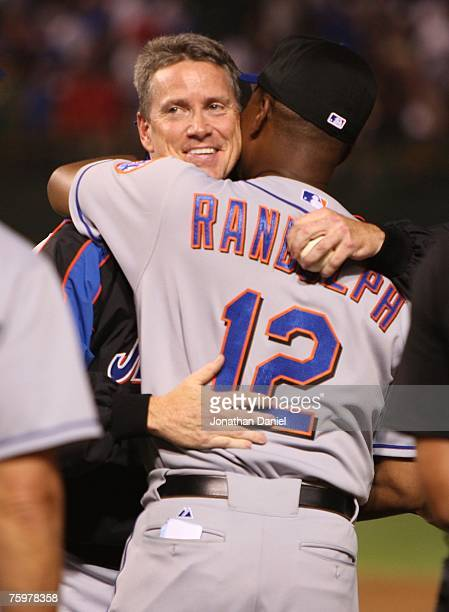 Pitcher Tom Glavine of the New York Mets hugs manager Willie Randolph after Glavine became the 23rd pitcher to win a 300th career game in beating the...