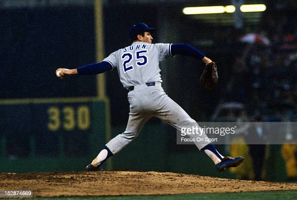 Pitcher Tommy John of the Los Angeles Dodgers pitches against the Philadelphia Phillies during an Major League Baseball game circa 1974 at Veterans...
