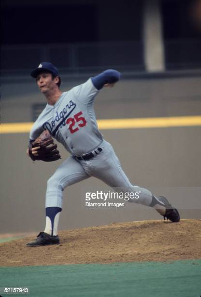 Pitcher Tommy John of the Los Angeles Dodgers pitches during a 1974 season game against the Cincinnati Reds at Riverfront Stadium in Cincinnati Ohio