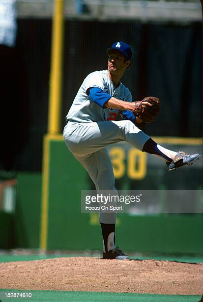 Pitcher Tommy John of the Los Angeles Dodgers pitches during an Major League Baseball game circa 1978 John played for the Dodgers from 197274 and...