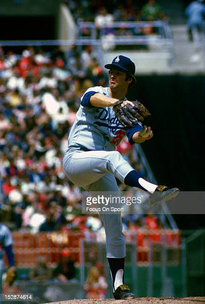 Pitcher Tommy John of the Los Angeles Dodgers pitches during an Major League Baseball game circa 1974 John played for the Dodgers from 197274 and...