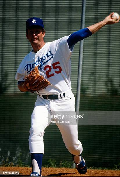 Pitcher Tommy John of the Los Angeles Dodgers warms up in the bullpen before the start of an Major League Baseball game circa 1974 at Dodger Stadium...