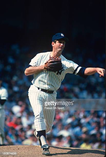 Pitcher Tommy John of the New York Yankees throws over to first base during an Major League Baseball game circa 1980 at Yankee Stadium in the Bronx...