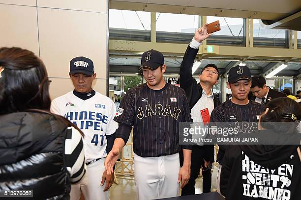 Pitcher Tomoyuki Sugano of Japan shakes hands with baseball fans during the charity session for the Great East Japan Earthquake five years ago and...