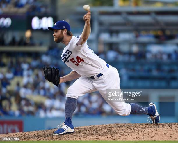 Pitcher Tony Cingrani of the Los Angeles Dodgers throws during the ninth inning against San Francisco Giants on Opening Day at Dodger Stadium on...