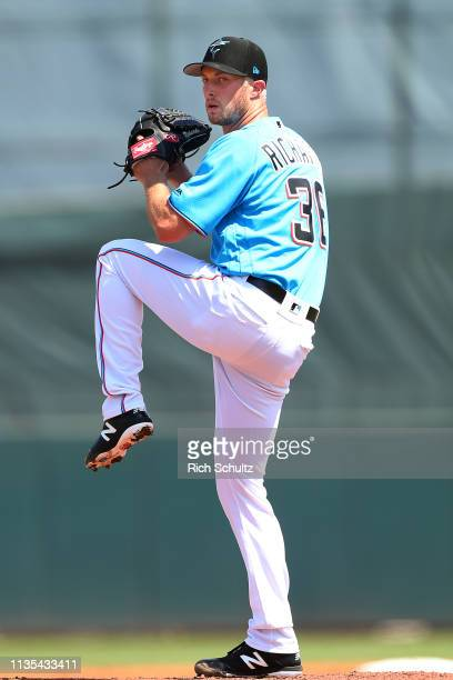 Pitcher Trevor Richards of the Miami Marlins in action against the New York Mets during a spring training baseball game at Roger Dean Stadium on...