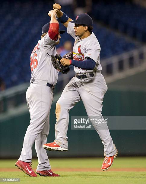 Pitcher Trevor Rosenthal and center fielder Jon Jay of the St Louis Cardinals react after defeating the Philadelphia Phillies 65 in twelve innings on...