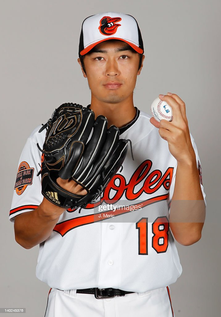 Pitcher Tsuyoshi Wada #18 of the Baltimore Orioles poses for a photo during photo day at Ed Smith Stadium on March 1, 2011 in Sarasota, Florida.