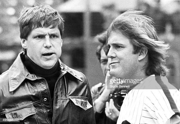 Pitcher Tug McGraw of the Philadelphia Phillies talks with former teammate Tom Seaver now of the Cincinnati Reds before Game 1 of the 1980 World...