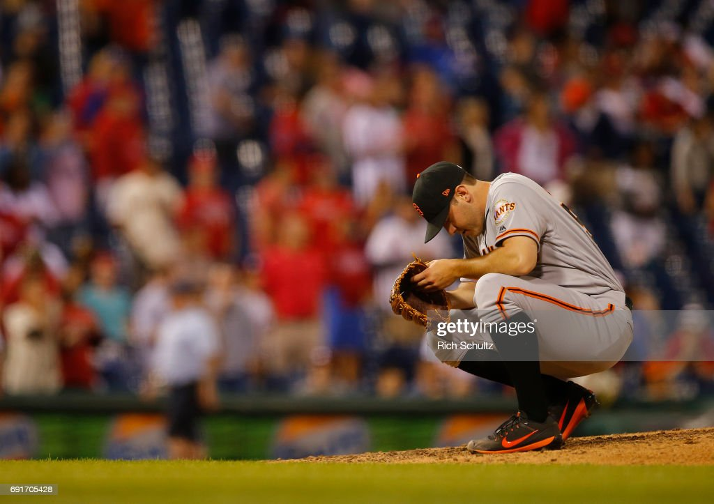 Pitcher Ty Blach #50 of the San Francisco Giants meditates before the seventh inning against the Philadelphia Phillies during a game at Citizens Bank Park on June 2, 2017 in Philadelphia, Pennsylvania.