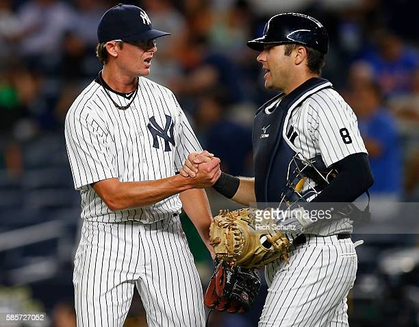 Pitcher Tyler Clippard and catcher Austin Romine of the New York Yankees congratulate each other after defeating the New York Mets 95 in a game at...