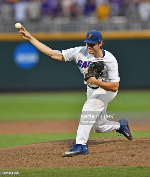 Pitcher Tyler Dyson of the Florida Gators delivers a pitch against the LSU Tigers in the fifth inning during game two of the College World Series...