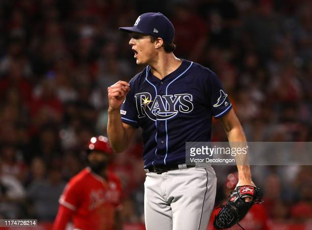 Pitcher Tyler Glasnow of the Tampa Bay Rays reacts after striking out Kole Calhoun of the Los Angeles Angels to end the third inning of the MLB game...