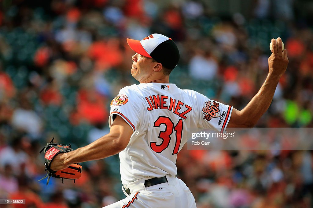 Pitcher Ubaldo Jimenez #31 of the Baltimore Orioles throws to a Minnesota Twins batter during the ninth inning of the Orioles 12-8 win at Oriole Park at Camden Yards on August 31, 2014 in Baltimore, Maryland.