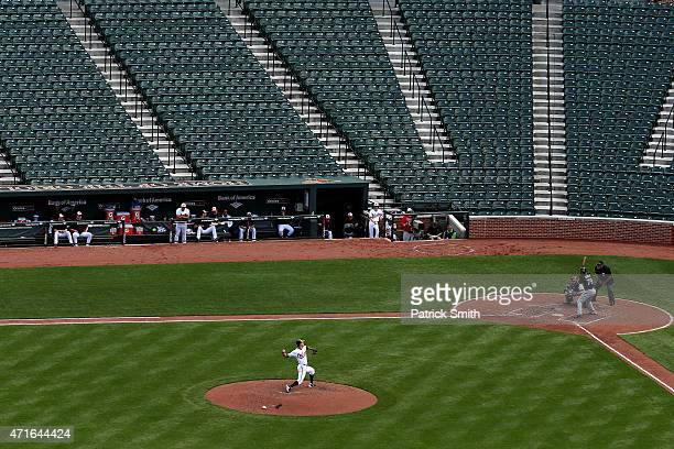 Pitcher Ubaldo Jimenez of the Baltimore Orioles works Jose Abreu of the Chicago White Sox in the sixth inning at an empty Oriole Park at Camden Yards...