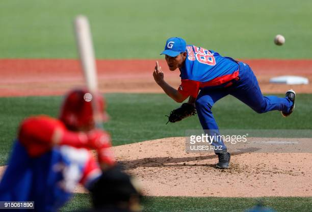 Pitcher Ulfrido Garcia of Cuba's Alazanes del Granma throws against Puerto Rico's Criollos de Caguas during the Caribbean Baseball Series at the...