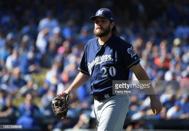 Pitcher Wade Miley of the Milwaukee Brewers leaves the game after facing one batter during the first inning of Game Five of the National League...
