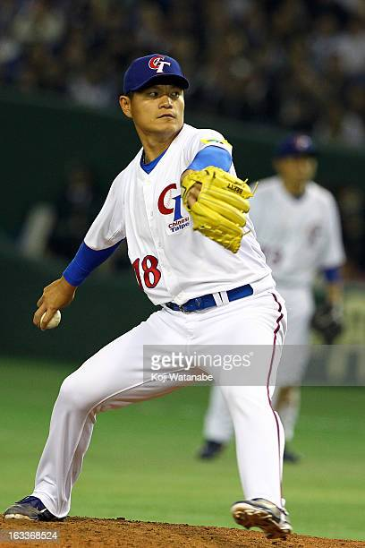 Pitcher WeiLun Pan of Chinese Taipei pitches during the World Baseball Classic Second Round Pool 1 game between Japan and Chinese Taipei at Tokyo...