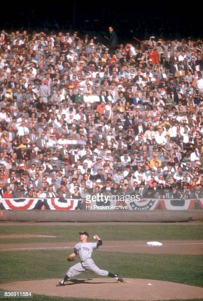 Pitcher Whitey Ford of the New York Yankees throws the pitch during Game 5 of the 1957 World Series on October 7 1957 at Milwaukee County Stadium in...