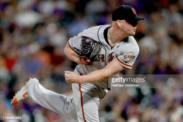 Pitcher Will Smith of the San Francisco Giants throws in the ninth inning against the Colorado Rockies at Coors Field on August 03 2019 in Denver...
