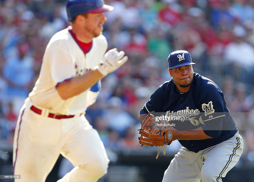 Pitcher Wily Peralta #60 of the Milwaukee Brewers fields a ball hit by Erik Kratz #31 of the Philadelphia Phillies and throws him out at first base during the fourth inning in a MLB baseball game on June 1, 2013 at Citizens Bank Park in Philadelphia, Pennsylvania. The Brewers defeated the Phillies 4-3.