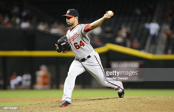 Pitcher Xavier Cedeno of the Washington Nationals pitches in the game against the Arizona Diamondbacks at Chase Field on September 27 2013 in Phoenix...