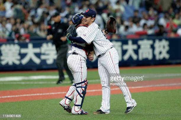 Pitcher Yasuaki Yamasaki and Catcher Takuya Kai of Japan celebrate after the game two between Japan and Mexico at Kyocera Dome Osaka on March 10,...