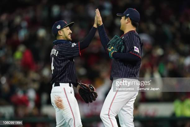 Pitcher Yasuaki Yamasaki and Catcher Takuya Kai of Japan celebrate their 53 victory in the game four between Japan and MLB All Stars at Mazda Zoom...