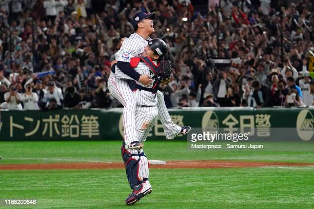 Pitcher Yasuaki Yamasaki and Catcher Tsubasa Aizawa of Japan celebrate winning the WBSC Premier 12 final game between Japan and South Korea at the...