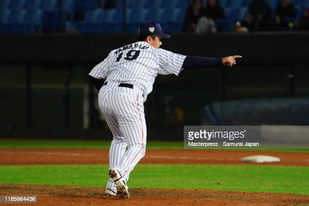 Pitcher Yasuaki Yamasaki of Japan celebrates winning after the top of 9th inning during the WBSC Premier 12 Opening Round Group B game between Japan...