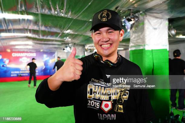 Pitcher Yasuaki Yamasaki of Japan poses for photographs after the champagne fight following the WBSC Premier 12 final game between Japan and South...