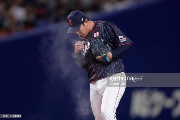 Pitcher Yasuaki Yamasaki of Japan prepares to pitch in the bottom of 9th inning during the game six between Japan and MLB All Stars at Nagoya Dome on...