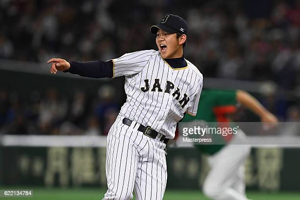 Pitcher Yasuaki Yamasaki of Japan reacts after allowing a RBI single to Outfielder Asael Sanchez of Mexico in the ninth inning during the...