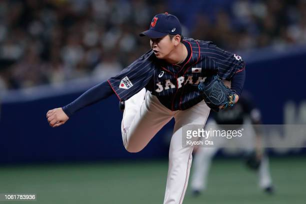 Pitcher Yasuaki Yamasaki of Japan throws in the bottom of 9th inning during the game six between Japan and MLB All Stars at Nagoya Dome on November...