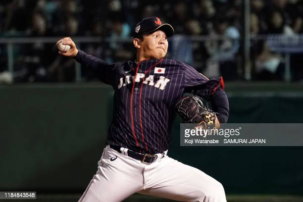 Pitcher Yasuaki Yamasaki of Japan throws in the bottom of 9th inning during the game two between Samurai Japan and Canada at the Okinawa Cellular...
