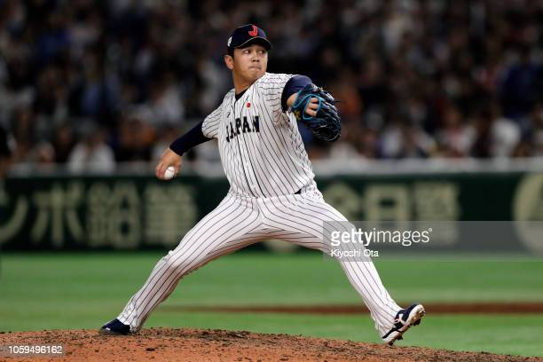 Pitcher Yasuaki Yamasaki of Japan throws in the top of 9th inning during the game one of the Japan and MLB All Stars at Tokyo Dome on November 9,...