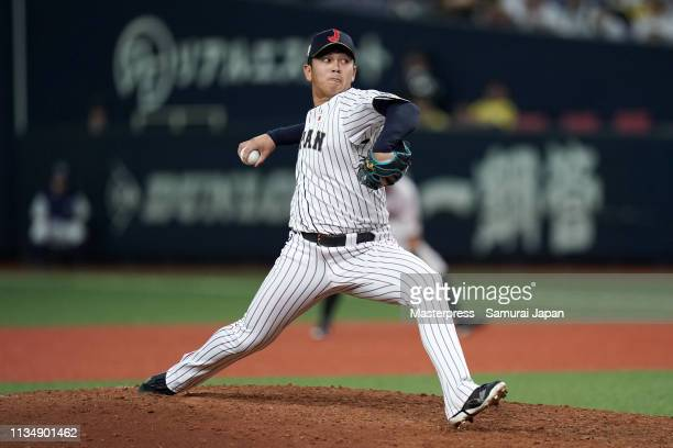 Pitcher Yasuaki Yamasaki of Japan throws in the top of 9th inning during the game two between Japan and Mexico at Kyocera Dome Osaka on March 10,...