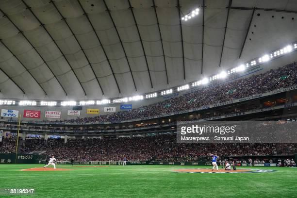 Pitcher Yasuaki Yamasaki of Japan throws in the top of 9th inning during the WBSC Premier 12 final game between Japan and South Korea at the Tokyo...