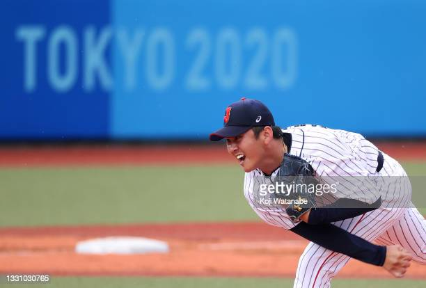 Pitcher Yasuaki Yamasaki of Team Japan pitches in the eighth inning against Team Dominican Republic during the baseball opening round Group A game on...