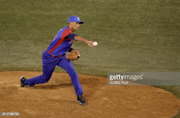 Pitcher Yoalkis Cruz of Alazanes del Granma of Cuba throws against Aguilas Cibaenas of Republica Dominicana during the Caribbean Baseball Series at...